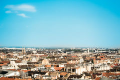 Beautiful panoramic aerial view over the roofs of Budapest, old orange tile roofs of buildings and churches on sunny summer day Royalty Free Stock Photos
