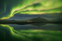 Beautiful panoramic Aurora Borealis or better known as The Northern Lights for background view in Iceland, Jokulsarlon. stock images