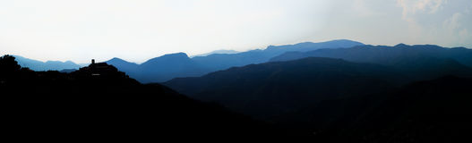 Beautiful panoramic bird-fly view to silhouettes of mountains, t Royalty Free Stock Photo