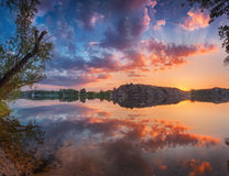 Beautiful panoramic landscape with colorful cloudy sky, lake and royalty free stock images