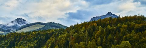 Beautiful panoramic landscape with colorful forests, Alpine mountains and dramatic sky near Wolfgangsee lake in Austria.  royalty free stock photos