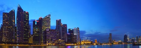 Beautiful panoramic landscape of Singapore city skyline at night with reflection Royalty Free Stock Image