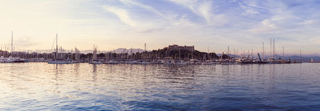 Beautiful panoramic marina view, sailboats and motorboats in port with a fort stock photos