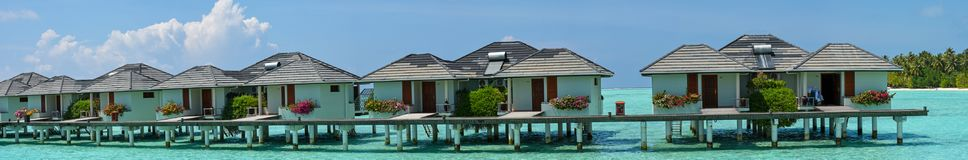 Beautiful panoramic photo of the water bungalows at the tropical island at Maldives. Beautiful panoramic photo of the water bungalows located at the tropical royalty free stock image