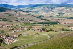 Beautiful panoramic and picturesque view of the Beaujolais wine region and the blooming vineyards at spring. Rhone-Alpes southeastern France. wine trips royalty free stock photos