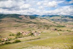 Beautiful panoramic and picturesque view of the Beaujolais wine region and the blooming vineyards at spring. Rhone-Alpes southeastern France. wine trips stock images