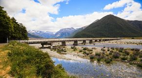 Beautiful Panoramic scenic view of Arthur`s pass bridge with Arthur`s Pass National Park Panoramic scenery in summertime. South Island, New Zealand royalty free stock image