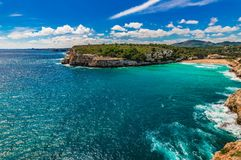 Beautiful panoramic seaside view of Cala Romantica beach on Mallorca island. Idyllic view of beach Cala Romantica, s`estany d`en mas on Majorca, Spain Royalty Free Stock Photography