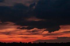 Beautiful panoramic sunset dramatic red sky with dark blue rainy stock photography