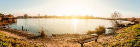 Beautiful panoramic sunset. Beautiful sunset over the lake. Panoramic view Stock Images