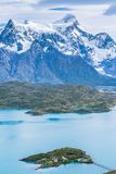 Beautiful panoramic view of aqua blue Pehoe lake with small island with nature cuernos mountains peak with cloud in autumn, Torres. Del Paine national park royalty free stock image