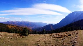 Panoramic view of Baiului and Bucegi mountains in autumn season. Beautiful panoramic view of Baiului and Bucegi mountains in autumn season, with colorful forest Stock Images