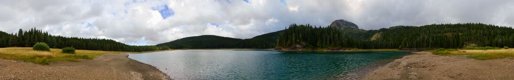 Panoramic view of Black Lake on cloudy September day, Montenegro. Beautiful panoramic view of Black Lake on cloudy September day, Durmitor National Park Stock Photos