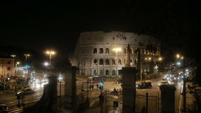 Beautiful panoramic view of the Coliseum in Rome, Italy. Famous historical building with lights in the evening. stock footage