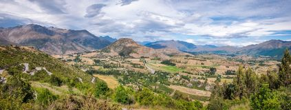 Beautiful Panoramic view on the Crown Range Road in New Zealand. Beautiful Panoramic view from Arrow Junction on the Crown Range Scenic Road in between Royalty Free Stock Photography