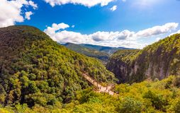 Beautiful panoramic view from the drone to Tourists On Observation Platform on Suspension Bridge Up To 140 Meters Above stock photography