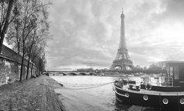 Beautiful panoramic view of the Eiffel Tower and Jena bridge fro. M the river Seine embankment. Dramatic cloudscape. Traditional sitycape in backlit morning royalty free stock photo