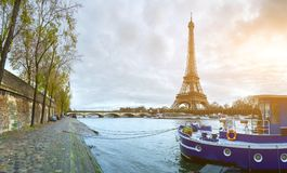Beautiful panoramic view of the Eiffel Tower and Jena bridge fro. M the river Seine embankment. Dramatic cloudscape. Traditional sitycape in backlit morning stock photography