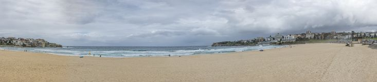 Beautiful panoramic view of the famous Bondi beach in Sydney, Australia on a cloudy day royalty free stock photo