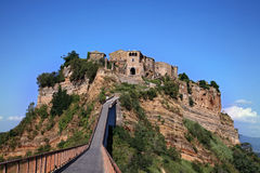 Beautiful panoramic view of famous Civita di Bagnoregio with Tiber river valley in golden evening light, Lazio Royalty Free Stock Photo