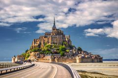 Beautiful panoramic view of famous Le Mont Saint-Michel tidal is. Land with blue sky. Normandy, northern France stock image