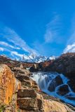 Beautiful panoramic view of Fitz roy mountains with white snow peak with colorful red orange leaves tree in sunny blue sky day,. Autumn, El Chalten, south royalty free stock photo
