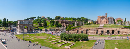 Beautiful panoramic view of the historical ruins in Rome. ROME, ITALY - JUNE, 6: Beautiful summer view from the Colosseum the arch of Constantine, temple of Stock Photo