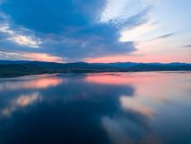 Beautiful panoramic view of the Lake on the sunset and hills on royalty free stock photography