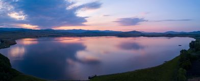 Beautiful panoramic view of the Lake on the sunset and hills on royalty free stock photo