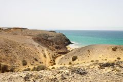 Beautiful panoramic view of Lanzarote sand dunes with beach in Playas de Papagayo, Costa del Rubicon, Canary Islands royalty free stock images