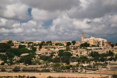 Beautiful panoramic view of Malta island and Mtarfa Clock Tower from the top of Bastion Square at Mdina, ancient capital of Malta royalty free stock photo