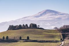 Beautiful panoramic view of Monte Amiata covered with snow from Monticchiello, Siena, Tuscany, Italy stock photo