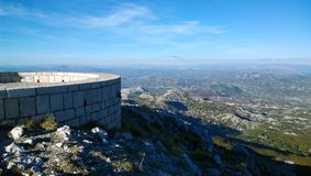Beautiful panoramic view of the observation deck at the mausoleum of Njegos on Lovcen in Montenegro. Horizontal view. Sky, rocks, mountains, hills in clear Stock Photo