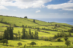 Beautiful panoramic view over the sunny fields and atlantic ocean from the top of the hill at Sao Miguel Island, Azores, Stock Image