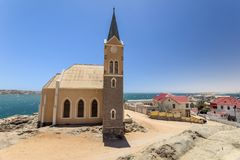 Beautiful panoramic view of the protestant german colonial church Felsenkirche in Lüderitz / Luderitz in Namibia, Africa. Royalty Free Stock Photos