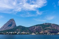 Beautiful panoramic view of the Sugar Loaf mountain in Rio de Janeiro, Brazil, on a beautiful and relaxing sunny day with blue sky stock images