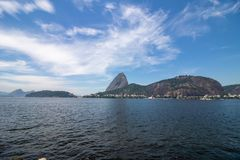 Beautiful panoramic view of the Sugar Loaf mountain in Rio de Janeiro, Brazil, on a beautiful and relaxing sunny day with blue sky stock photos