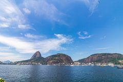 Beautiful panoramic view of the Sugar Loaf mountain in Rio de Janeiro, Brazil, on a beautiful and relaxing sunny day with blue sky royalty free stock photos