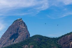 Beautiful panoramic view of the Sugar Loaf mountain in Rio de Janeiro, Brazil, on a beautiful and relaxing sunny day with blue sky stock image