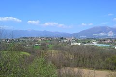 Panoramic view to the Alps of Lecco and the Brianza plain in a sunny spring day. royalty free stock images