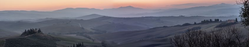 Beautiful panoramic view of the Tuscan countryside south of Siena in the light of dawn, Tuscany, Italy royalty free stock photo