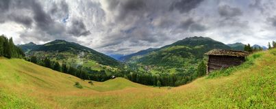 Swiss alps summer panorama with clouds Royalty Free Stock Photography