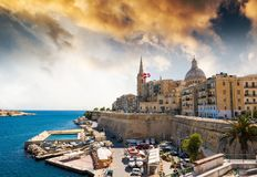 View on Valletta from sea. Beautiful panoramic view on Valletta in Malta at sunset Royalty Free Stock Image