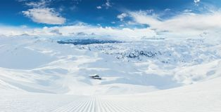 Beautiful panoramic winter landscape with piste stock photography
