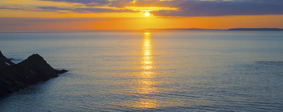 Beautiful panoramic yellow sunset over loop head Royalty Free Stock Images