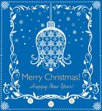 Beautiful paper blue applique for Christmas and New year greetings with hanging bell, snowflakes and decorative floral border Royalty Free Stock Photo