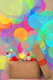 Gift on a bokeh of colourful party lights Royalty Free Stock Image