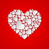 Beautiful  paper cut out heart with many small white hearts. Beautiful paper cut out heart with many small white hearts on red background. Vector illustration Stock Photos