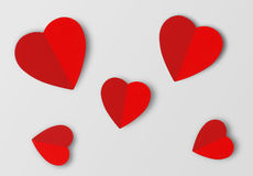 Beautiful paper hearts on grey paper background Royalty Free Stock Photo
