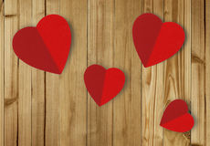 Beautiful paper hearts on wooden background Royalty Free Stock Photos
